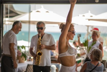 dancer girl bikini bedacelledswimsuit trumpeteer champagnelunch party beachclub