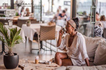 lounge restaurant woman coffee palmtree sofa