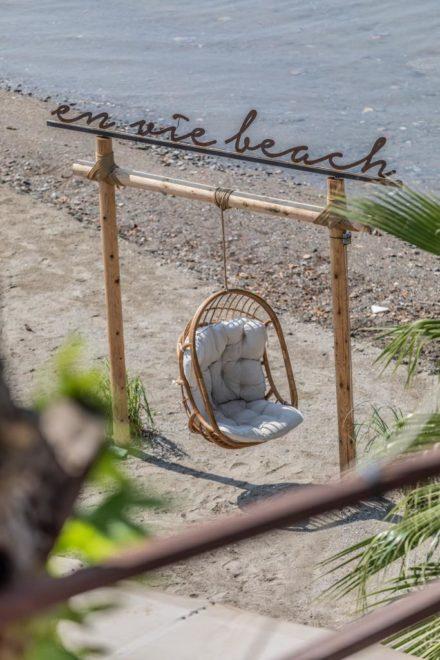 selfiechair beach sea water palmtrea palm chair enviebeach sign