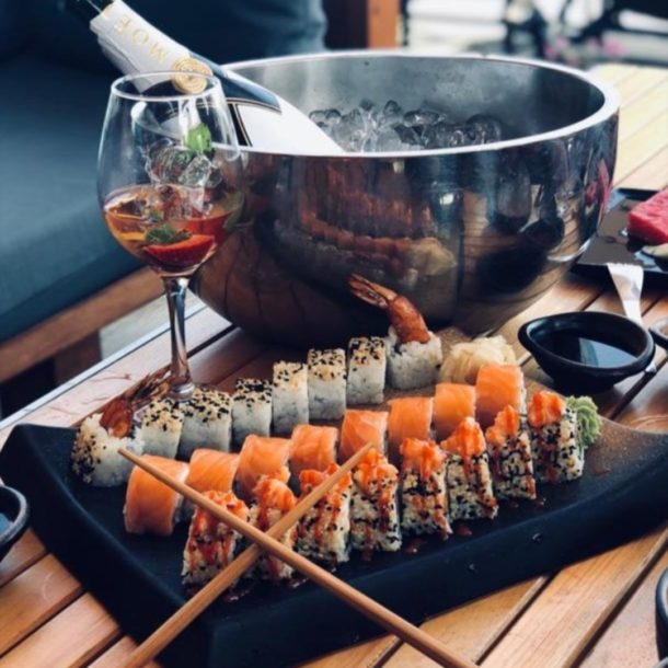 moet champagne sushi roll california ebi tempura spicysalmon lunch on the beach